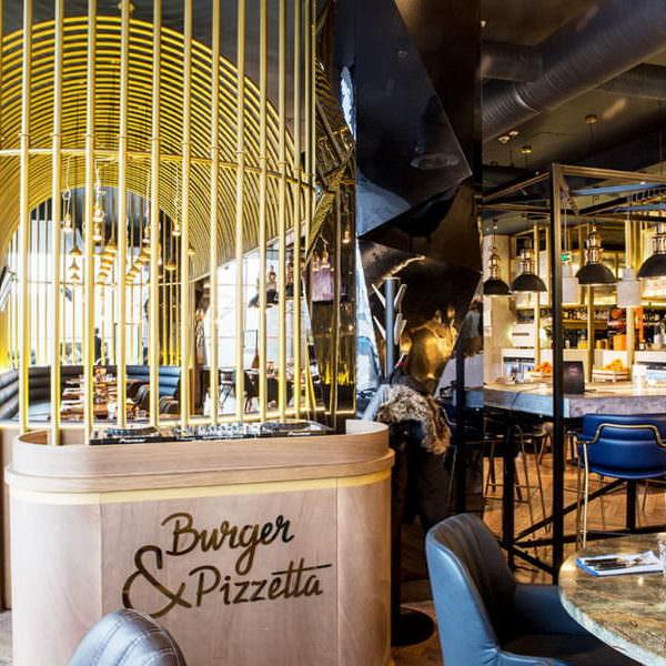 Профессиональное оборудование для кухни от Profitex. Ресторан Burger&Pizzetta, Москва. На фото интерьер зала ресторана.